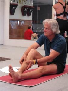 Bill Lockton self massaging his shin